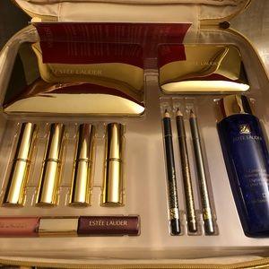 Estée Lauder mega makeup kit with metallic bag.